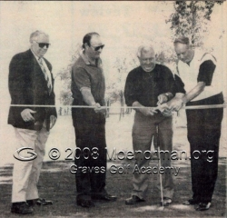 1994_moe_norman_cuts_ribbon_to_open_gold_course